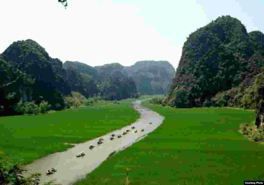 Trang An, in Vietnam, is a spectacular landscape of limestone karst peaks permeated with valleys, some of which are submerged, and surrounded by steep, almost vertical cliffs. (UNESCO)