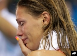 Russia's Yulia Efimova cries after placing second in the women's 100-meter breaststroke final during the swimming competitions at the 2016 Summer Olympics, Monday, Aug. 8, 2016.