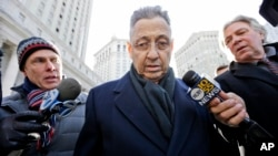 Former New York State Assembly Speaker Sheldon Silver, center, is surrounded by members of the media as he leaves a federal courthouse in New York, Feb. 24, 2015.
