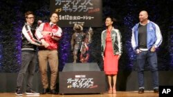"Director James Gunn (from left) actors Chris Pratt, Zoe Saldana and Dave Bautista pose for photographers during a media conference of ""Guardians of the Galaxy Vol. 2"" in Tokyo, April 11, 2017."