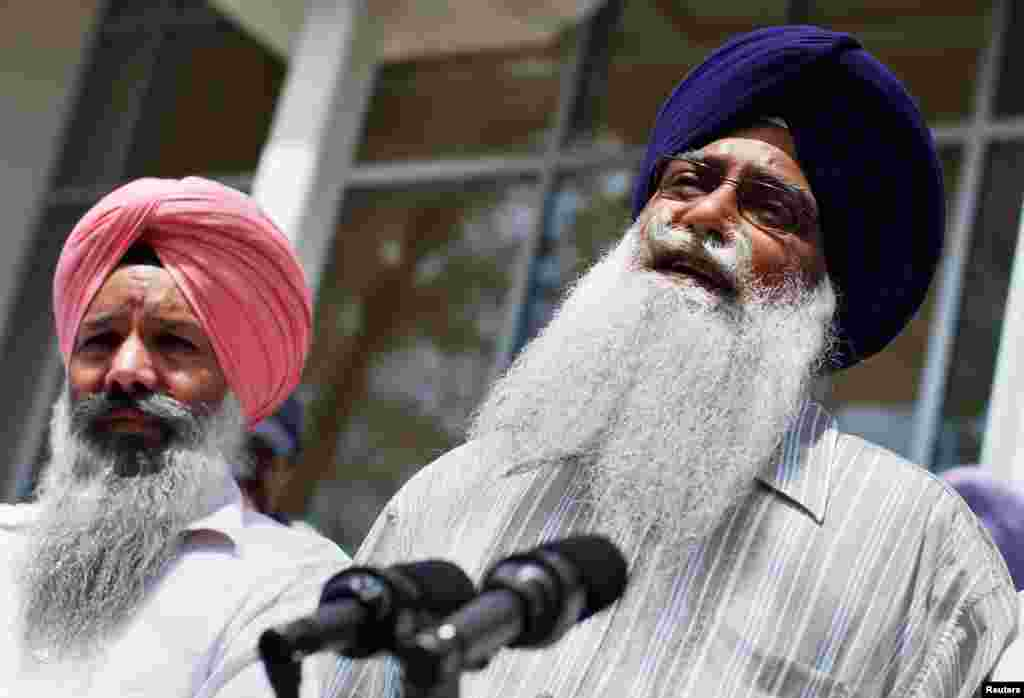 Mohan Singh Khatra (R), who lost his uncle Subeg Singh Khatra in the shootings, speaks to the media outside the Sikh Cultural Society in Queens, New York, August 6, 2012.