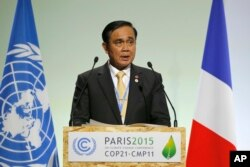 Thailand's Prime Minister Prayuth Chan-Ocha addresses world leaders at the COP21, United Nations Climate Change Conference, in Le Bourget, outside Paris, Nov. 30, 2015.