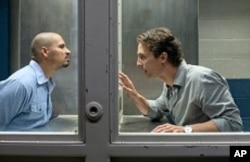 "Jesus Martinez (Michael Pena) left, and Mick Halle (Matthew McConaughey) right in ""The Lincoln Lawyer"""