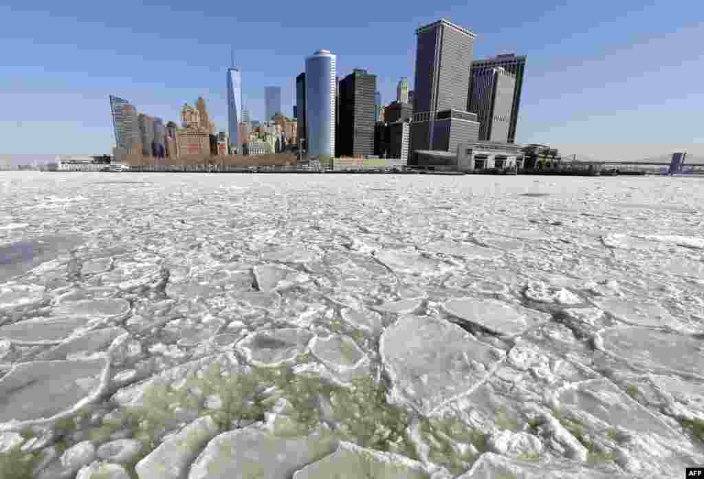 A view of Lower Manhattan from the Staten Island ferry as the New York Harbor is filled with large chunks of ice. Heavy ice in the East River shut down commuter ferry service between Manhatta, Queens, and Brooklyn on Feb. 24, 2015.