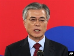 FILE - Democratic United Party's Moon Jae-in speaks during a press conference.