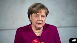 FILE - German chancellor Angela Merkel delivers a statement in Berlin, Jan. 7, 2018.