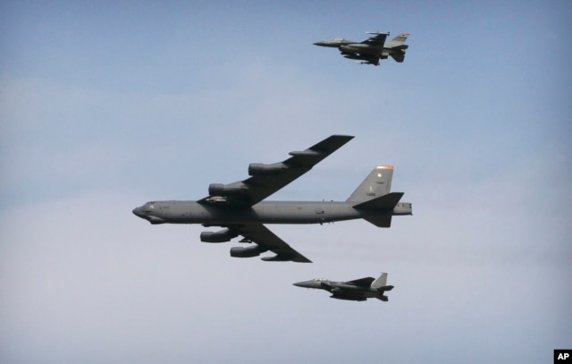 A U.S. Air Force B-52 bomber flies over Osan Air Base in Pyeongtaek, South Korea, Jan. 10, 2016.