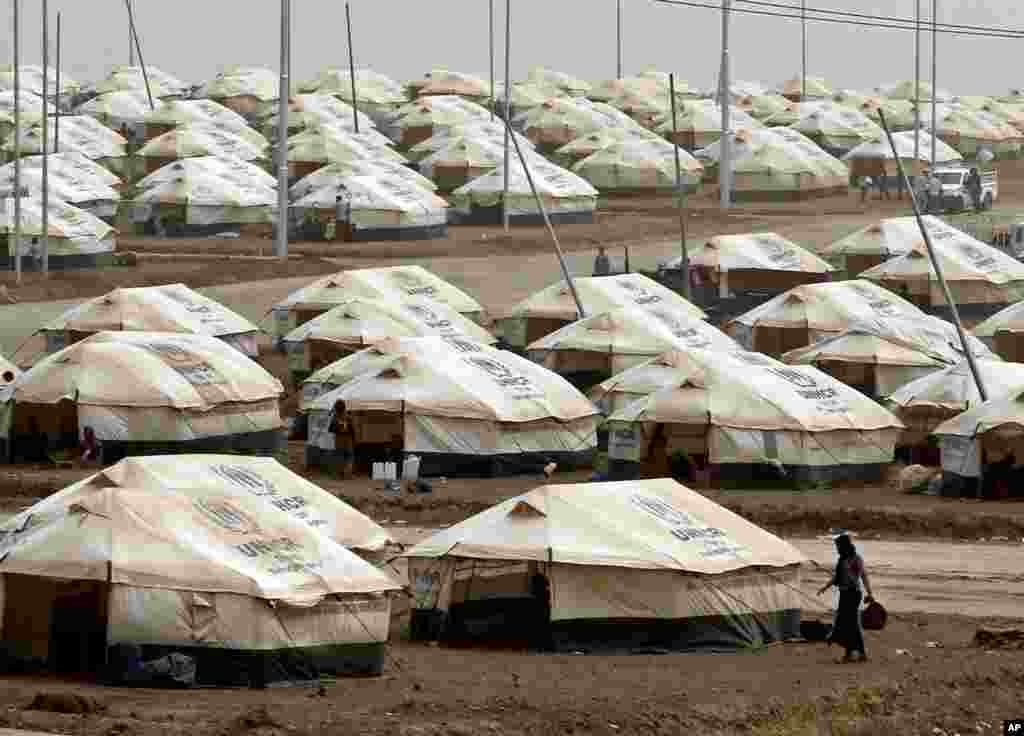 About 1.5 million people have been displaced by fighting in Iraq since the Islamic State's rapid advance began in June. Displaced Iraqis settle at this new camp, in Feeshkhabour town, Iraq,  Aug. 19, 2014.