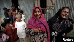 Rohingya refugees react before the funeral of a family member, who they say succumbed to injuries inflicted by the Myanmar Army before their arrival, in Cox's Bazar, Bangladesh, Sept. 29, 2017.