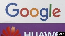 资料照片:法国巴黎科技贸易展览会上展示的谷歌与华为公司的标识(2019年5页19日)