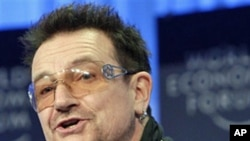 Irish musician Bono speaks during the World Economic Forum in Davos, January 28, 2011