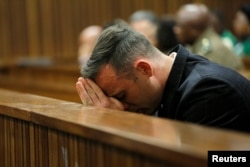 Former Paralympian Oscar Pistorius appears for sentencing for the murder of Reeva Steenkamp at the Pretoria High Court, South Africa, June 14, 2016.