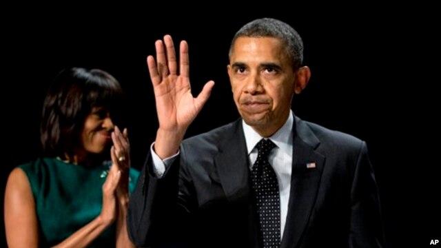 Presiden Obama dan Ibu Negara Michelle Obama menghadiri acara tahunan sarapan dan doa nasional di Washington, Kamis (7/2).