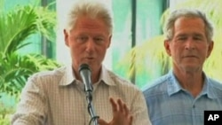 Former presidents Bill Clinton and George Bush speak about giving aid to Haiti. (file)