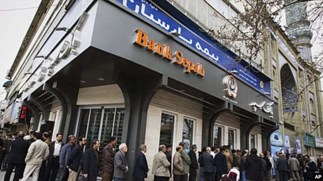 People stand in line to cast their votes at a mosque in eastern Tehran, Iran, during the parliamentary election,  March 2, 2012.