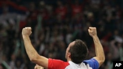 Viktor Troicki of Serbia celebrates after the Serbian national tennis team won the Davis Cup finals against France in Belgrade, Serbia, Sunday, Dec. 5, 2010.