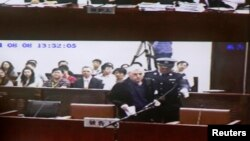 An internal court video shows British investigator Peter Humphrey arriving at a courtroom after a lunch break, during his trial at Shanghai No.1 Intermediate People's Court, August 8, 2014.