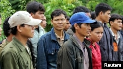 FILE - A group of Montagnards are seen after they emerged from a dense forest some 70 km (44 miles) northeast of Ban Lung, located in Cambodia's northeastern province of Ratanakiri, on July 22, 2004.