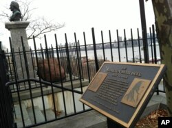 The plaque and bust of Alexander Hamilton mark the dueling grounds where Hamilton was fatally shot by Aaron Burr in 1804.