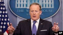 FILE - White House press secretary Sean Spicer speaks during the daily press briefing at the White House in Washington, March 13, 2017.