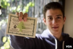 Unable to claim Lebanese citizenship despite living in the country all his life, 20-year-old Bassam Nahhas must carry a residency permit. He is planning to leave the country (VOA/J. Owens).