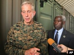 FILE - Gen. Thomas D. Waldhauser, left, commander of U.S. Africa Command, speaks in Dakar, Senegal, July 30, 2018.