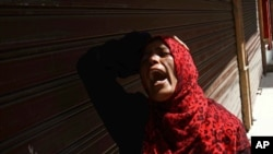 An Egyptian woman mourns after a judge sentenced to death 683 alleged supporters of the country's ousted Islamist president over acts of violence and the murder of policemen in the latest mass trial in the southern city of Minya, Egypt, April 28, 2014.