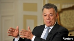 Colombia's outgoing President Juan Manuel Santos speaks with Reuters at the presidential palace, in Bogota, Colombia, July 30, 2018.
