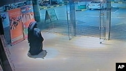 FILE - This image made from video released by the Abu Dhabi police department on Dec. 2, 2014 shows a veiled suspect in the stabbing of an American teacher in a shopping mall restroom as seen on security camera footage in Abu Dhabi, UAE.