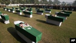 People offer funeral prayers of Saturday's NATO attack victims in Peshawar, Pakistan, November 27, 2011.