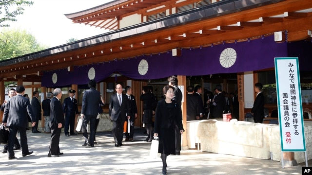 Japanese lawmakers leave after visiting Yasukuni Shrine, which honors Japan's war dead, including World War II leaders convicted of war crimes in Tokyo, April 23, 2013.