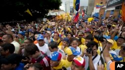 Unjuk rasa menentang pemerintah Presiden Nicolas Maduro. Caracas, Venezuela. (AP Photo/Ariana Cubillos)