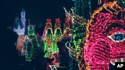 FILE -The Main Street Electrical Parade moves down Main Street in Disneyland, in Anaheim, Calif., during its last night of performances, Nov. 25, 1996.
