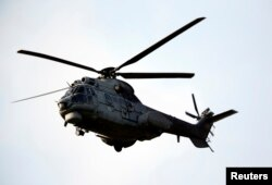A Turkish Air Force AS-532AL Cougar helicopter takes off from Incirlik airbase in the southern city of Adana, Turkey, July 27, 2015.