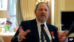 FILE - U.S. movie mogul Harvey Weinstein is seen during an interview in Paris, March 7, 2012.