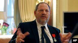 FILE - U.S. movie mogul Harvey Weinstein is seen during an interview in Paris, March 7, 2012, the same day he was named Chevalier of the Legion of Honor by then French president Nicolas Sarkozy.