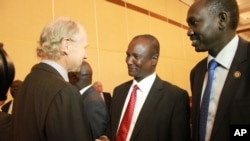 Taban Deng Gai, chief negotiator from South Sudan's opposition, center, shakes hands with an unidentified western observer in Addis Ababa, Ethiopia, Jan. 4, 2014.