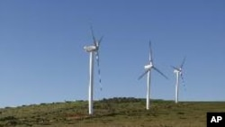Giant wind turbines dot the landscape at the Darling Wind Power national demonstration project near Cape Town.