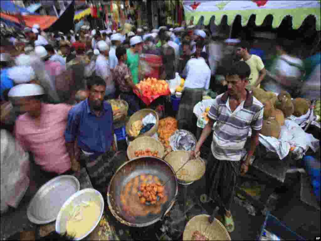 People prepare food to sell for iftar (breaking fast) at Chakbazaar during the holy month of Ramadan in Dhaka
