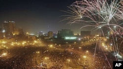 Fireworks explode as tens of thousands of Egyptians celebrate the fall of the regime of former President Hosni Mubarak in Tahrir Square in downtown Cairo, Egypt, February 18, 2011.