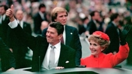 President Ronald Reagan and his wife Nancy during the inaugural parade in Washington following his swearing in as the 40th president of the United States on January 20, 1981