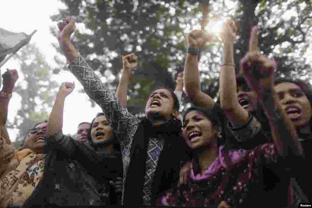 Garment workers and leaders shout slogans as they protest the deaths of their colleagues after a devastating fire in a garment factory in Dhaka, Bangladesh, November 27, 2012.