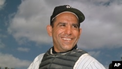 File-New York Yankee catcher Yogi Berra poses at spring training in Florida, in an undated file photo. Berra, the Yankees Hall of Fame catcher died in 2015. He was 90. (AP Photo/File)