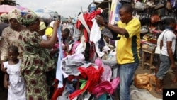 In this photo taken June 18, 2012, people buy secondhand clothes at Katangua market in Lagos, Nigeria.