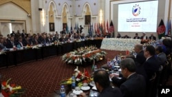 FILE - Delegates attend the 2nd Kabul Process conference at the Presidential Palace in Kabul, Feb. 28, 2018.
