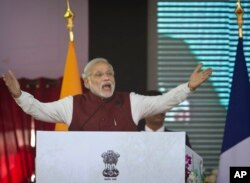 FILE - Indian Prime Minister Narendra Modi speaks during the foundation stone laying for the headquarters of the International Solar Alliance at Gurgaon, outskirts of New Delhi, India, Jan. 25, 2016.