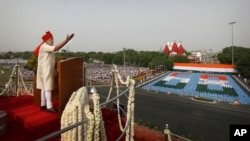 Indian Prime Minister Narendra Modi, addresses the nation from the ramparts of Red Fort to celebrate Independence Day in New Delhi, India, Friday, Aug. 15, 2014.