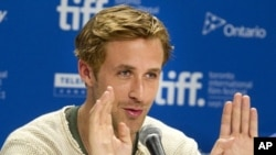 "Actor Ryan Gosling speaks at a news conference for the film ""The Ides of March"" at the 36th Toronto International Film Festival September 9, 2011."