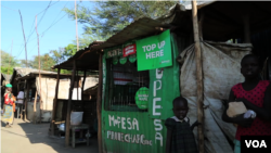 A solar-powered charging station for mobile phones at Kakuma. (M. Yusuf/VOA)