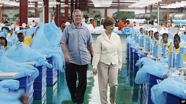 George W. Bush and Laura Bush tour A to Z textile mills, which produces insecticide mosquito nets to combat malaria, in Arusha, Tanzania, Feb. 18, 2008.